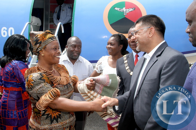 First Lady Esther Lungu being welcomed by Steven Din, KCM Chief Executive Officer on arrival at Kasompe Air stripe on Monday, December 7,2015 to check and witness various projects that are being undertaken by various stakeholders and those that are undertaken by Konkola Copper Mine (KCM) under Corporate Social responsibility -Picture by THOMAS NSAMA