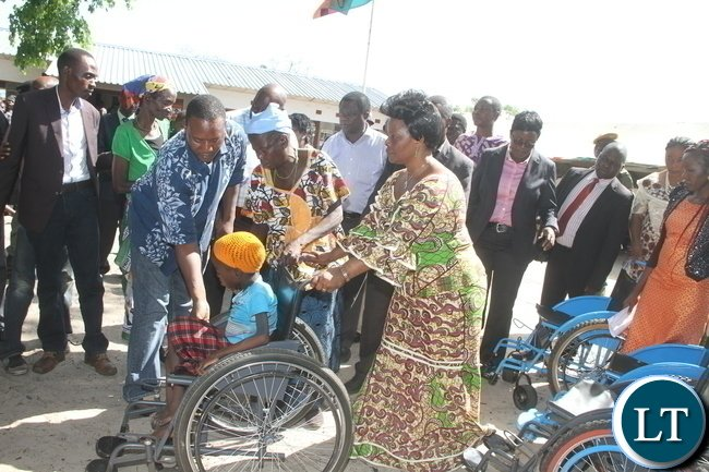 CAPTION: First Lady Esther Lungu during the handover of assistive devices to the victims of Konzo diseases in Luatembo village in Mongu District on Wednesday, December 16,2015 -Pictures by THOMAS NSAMA