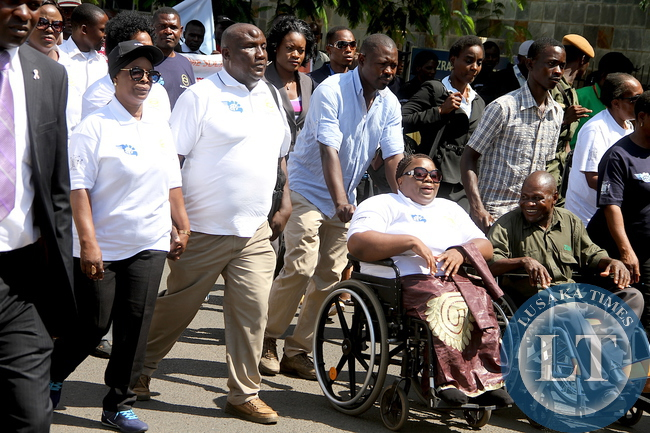 First Lady Esther Lungu marching from Northmead to Showgrounds during the Commemoration of the International Day for Persons with Disabilities on Thursday, December 3,2015 -Picture by THOMAS NSAMA