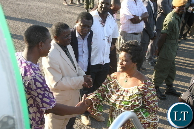 First Lady Esther Lungu  greets  Western province minister Poniso Njeulu  shortly before departure at Mongu airport for Lusaka. The First Lady was in Mongu District where she handover of assistive devices to the victims of Konzo diseases in Luatembo village  on Tuesday, December 15,2015 -Pictures by THOMAS NSAMA