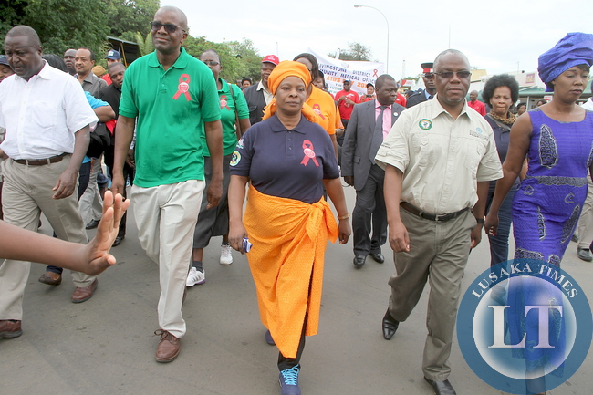 First Lady Esther Lungu with Southern Province minister Nathaniel Mubukwanu during the World AIDS day Commemoration march past in Livingstone on Monday, December 1,2015 -Picture by THOMAS NSAMA