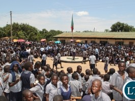 Pupils at Mulenga Primary School in Kitwe waiting for Miss Tasila Lungu to receive new shoes.Miss Tasila Lungu was at the school distributing shoes donated by Anchor of Hope Charities, an American NGO providing new shoes to underprivileged and vulnerable children in Zambia.