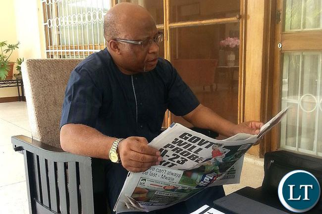 Nevers Mumba reading The Post newspaper