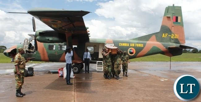 Officers from Zambia Air Force carrying the casket of the late Chief Fwambo upon arrival from Lusaka at Samora Machel Airbase in Mbala