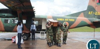 Pall bearers from Zambia Air Force in Mbala carrying the casket of the late Chief Fwambo of the Mambwe people after arrival from Lusaka
