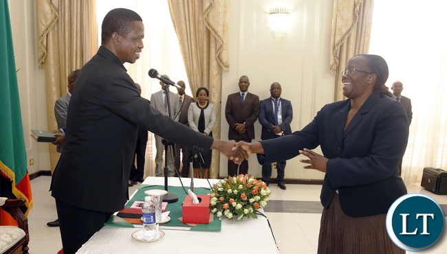 President Edgar Lungu thanks from Madam Doris Mwinga clerck of the National assembly the Constitution Amendment bill that was passed by parliament last week. President Edgar Lungu reiterating that he would assent to the document in the first week of January, next year. PICTURE BY EDDIE MWANALEZA/STATEHOUSE . 23-12-2015