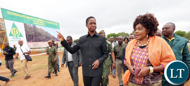 President Edgar Chagwa Lungu with Minister of Lands and Natural Resources Ms Christable Ngimbu during the launching the ZAFFICO Shiwang'andu Forest plantation on Tuesday,December 15,2015 in Muchinga Province. PICTURE BY EDDIE MWANALEZA/STATE HOUSE ©2015