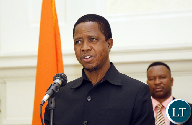 President Edgar Lungu after he received the Constitution Amendment bill that was passed by parliament last week. President Edgar Lungu reiterating that he would assent to the document in the first week of January, next year. PICTURE BY EDDIE MWANALEZA/STATEHOUSE . 23-12-2015