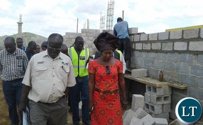 WORKS and Supply deputy Minister Mutaba Mwali (left) with Chikankanta District Commissioner Kavumbu Hakachima inspect a police station under construction in the district. Picture y CHILA NAMAIKO