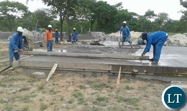 ANITA Construction Limited employees work on foundation among the 20 low-cost housing units under construction for civil servants in Mulobezi District. Picture by CHILA NAMAIKO