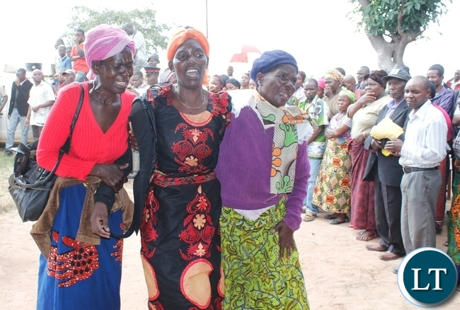 Wife of the late Chief Fwambo (c) being supported by elderly women arrives at the funeral house
