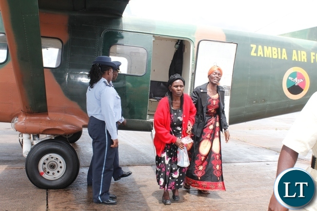Wife of the late Chief Fwambo (r) alights from the Zambia Air Foce plane carrying the body of the late chief from Lusaka at Samora Machel Airbase in Mbala