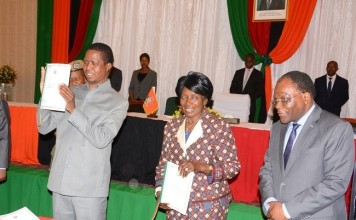 President Eedgar Lungu and Vice President Inonge Wine shows the document after the launch whilst Secretary to the cabinet Rowland Msiska Looks on during the Launch of the Perfromance-Based Contract system for Permanent secretaries at Government Complex