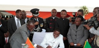 President of the Republic of Zambia, Mr. Edgar Chagwa Lungu signing the Constitution Bill during the Assenting of the Constitutional Bill Ceremony at Heroes Stadium yesterday 05-01-2016. Picture by ROYD SIBAJENE/ZANIS