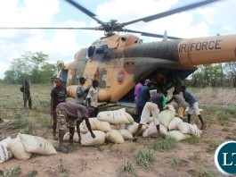 Government through Disaster Management and Mitigation Unit (DMMU) has started airlifting relief Maize to Luano Valley in a bid to mitigate the hunger situation in the area. In the picture, residents getting maize from the ZAF chopper