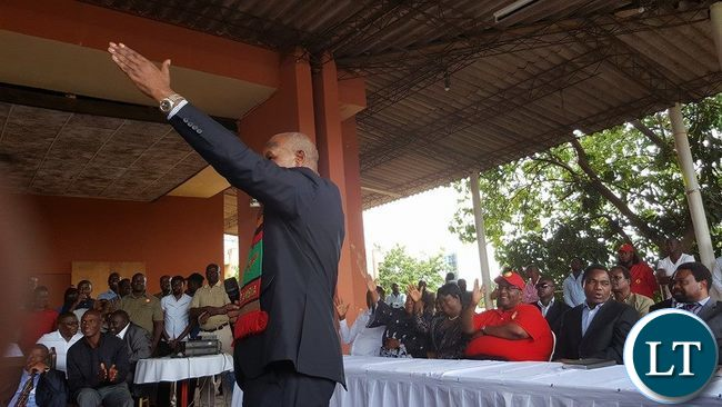 Lupando Mwape shows the UPND symbol