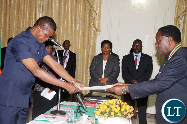 President Edgar Lungu receives an affidavit of Oath from North-Western Province Permanent Secretary Ephraim  Mateyo during the Swearing-In-Ceremony at State House on Wednesday, January 27,2016 -Picture by THOMAS NSAMA/STATE HOUSE