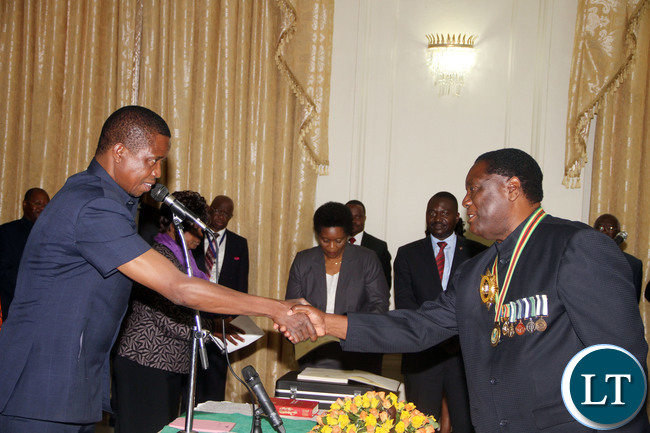 President Edgar Lungu congratulates Newly appointed  North-Western Province Permanent Secretary Ephraim  Mateyo during the Swearing-In-Ceremony at State House on Wednesday, January 27,2016 -Picture by THOMAS NSAMA/STATE HOUSE