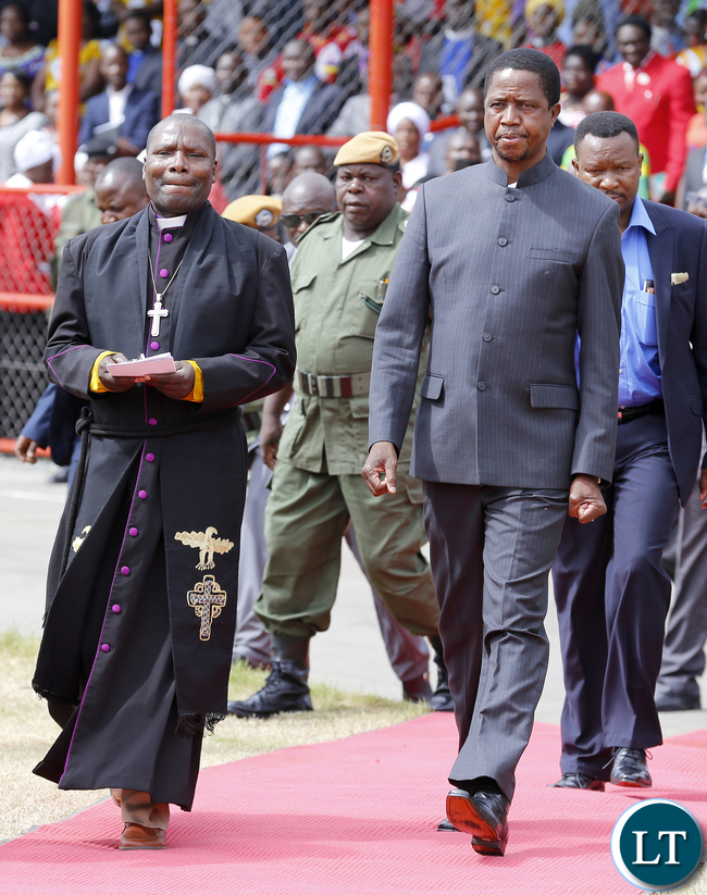 President Edgar Lungu with Synod general sceretary Bishop Rev Mutale Mulumbwa at Golden Jubillee Celebration closing Worship at Nkana Stadium in Kitwe. The United Church of Zambia celebrated 50 years of existence with a series of events, the Synod Bishop, the Synod General Secretary and the clergy and church members from the various presbyteries, consistories and congregations._ PICTURE BY EDDIE MWANALEZA/STATEHOUSE17-1-2016.