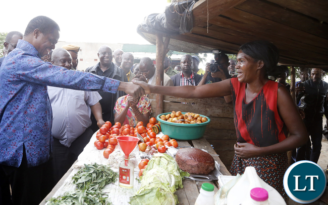 President Edgar Chagwa Lungu greets supporters at Baluba Road Side Market on Ndola - Kitwe Dual High Way the First Family stopped over to Meet Traders and Exchanges Views 16-01-2016, PICTURE BY EDDIE MWANALEZA/STATEHOUSE