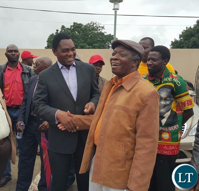 UPND leader Hakainde Hichilema shares a light moment with People's Party President Mike Mulongoti at the Courtyard Hotel in Lusaka after a joint press conference by various opposition political parties in Zambia.
