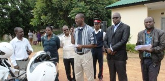 Kasama District Commissioner Kelly Kashiwa (stripped T/Shirt) hands over 22 motorbikes worth US 66000 dollars in Kasama today, donated by the Scaling up Nutrition (SUN) Programme for Kasama and Kaputa districts in Northern Province. Looking on is SUN Provincial Coordinator Mata Nyambe - Picture by Mary Bwembya (ZANIS).