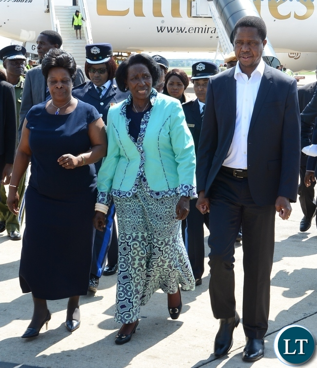 resident Edgar Lungu (r) flanked by Vice President Inonge Wina (c) and the first Lady Esther Lungu (l) on his arrival at Kenneth Kaunda International Airport from France