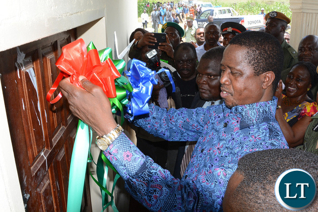 President Lungu and Southern Province Minister Nathaniel Mubukwanu show party symbol on his arrival at Namwala ground