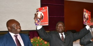 Minister of Works and Supply Yafwa Mukanga shows the Training Manual whilst Permanent Secretary Local Government Amos Mulupenga looks on shortly after the launch of the manual at Golden Peacock