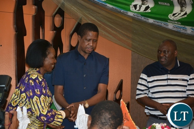 President Edgar Lungu chats with Vice President Inonge Wina whilst PF Secretary General Davies Chama looks at the women Sensitization and Funderising Breakfast  Programme at Intercontinetal Hotel in Lusaka