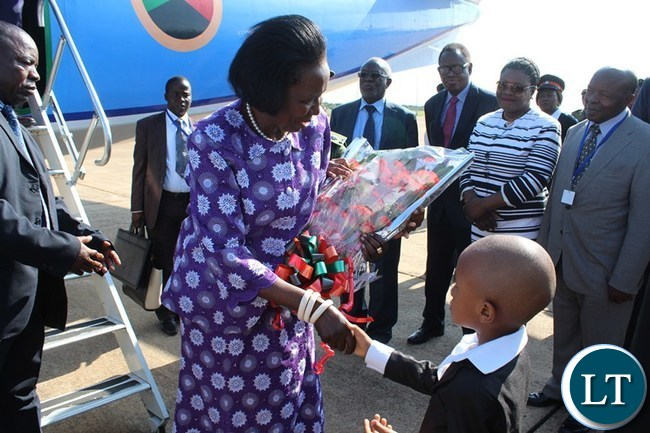 VICE President Inonge Wina shakes hands with a 6 year old Emmanuel Mfula after receiving flowers from at Harry Mwanga Nkumbula International Airport in Livingstone on Wednesday. The Vice President was in Livingstone to officiate at African Regional Labour Administration Centre (ARLAC) governing council meeting