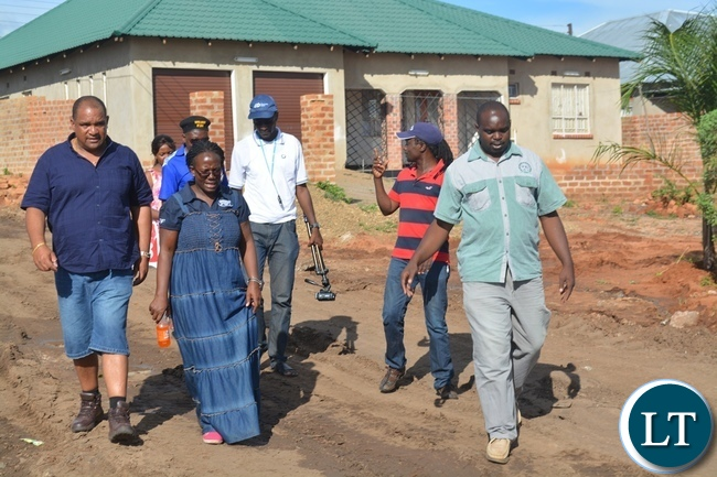 Livingstone Member of Parliament Lawrence Evans (far left), Livingstone Town Clerk Vivian Chikoti (middle) and Livingstone District Commissioner Omar Munsanje (far right) inspecting some roads and houses damaged by the recent heavy rains in the tourist capital.