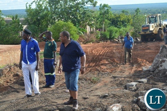 Livingstone Member of Parliament Lawrence Evans (middle) inspects some roads and houses damaged by the recent heavy rains in the tourist capital