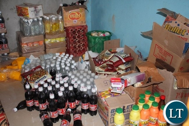 Assortment of expired food stuffs, cosmetics, drugs and body lotions that were confiscated by health inspectors being destroyed