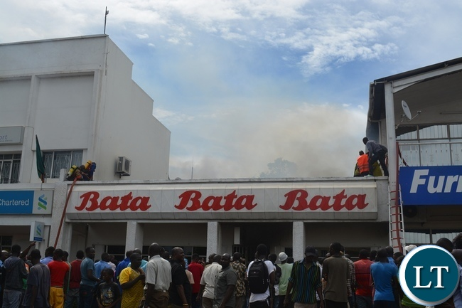 Some Livingstone residents watch helplessly as Bata town centre outlet caught fire in Livingstone