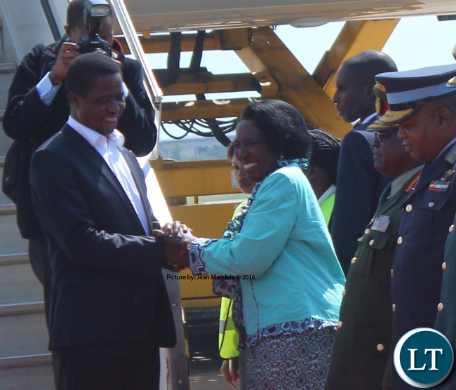 President Edgar Lungu being welcomed by Vice President Inonge Wina on his arrival at Kenneth Kaunda International Airport from France