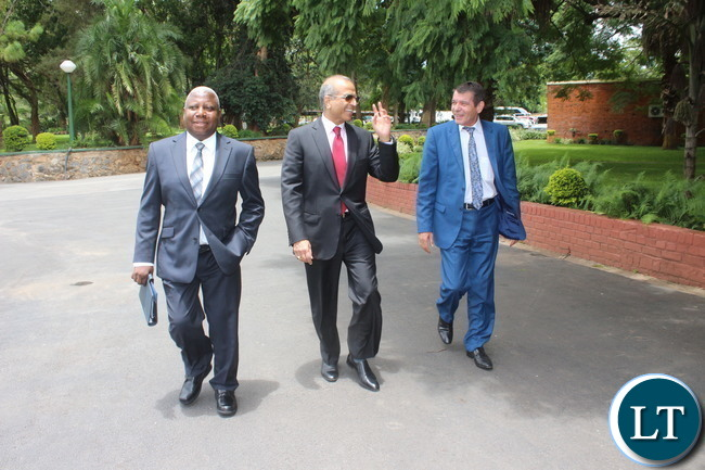 In the middle Bharti Airtel CEO and Chairman Sunil Bharti Mittal with Airtel Networks Zambia Plc Board Chairman George Sokota and Airtel Africa MD & CEO Christian da Faria working at Lusaka State House.