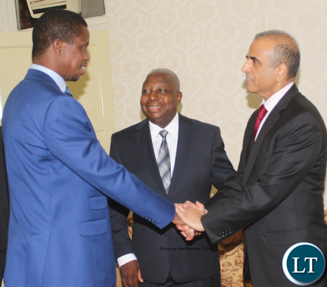 President Edgar Chagwa Lungu shaking hands with Bharti Airtel CEO and Chairman Sunil Bharti Mittal while looking on is Airtel Networks Zambia Plc Board Chairman George Sokota at State House when the Bharti Airtel CEO paid a courtesy call