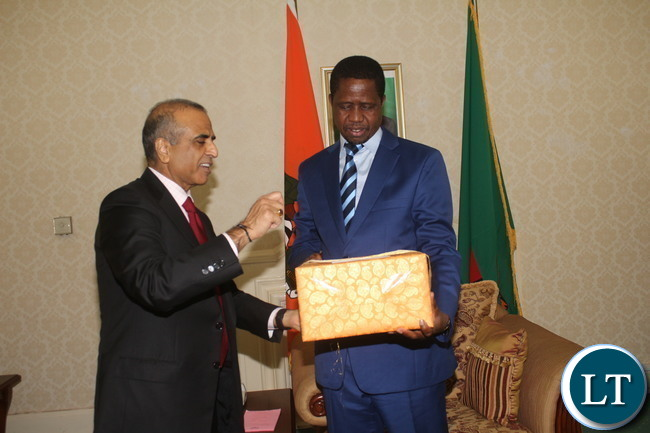 President Edgar Chagwa Lungu receiving a present from Bharti Airtel CEO and Chairman Sunil Bharti Mittal.