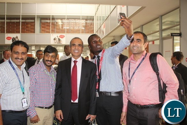 Bharti Airtel CEO and Chairman Sunil Bharti Mittal taking Selfies with Staff