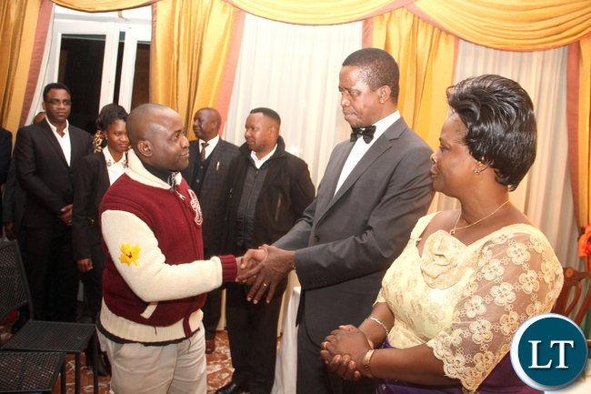 President Lungu  greets one of the Zambian's living in Italy as First Lady Esther Lungu looks on during dinner hosted for  him by Zambia's Ambassador to Italy Gertrude Mwape  in Rome on Friday, February 6,2016 -Picture by THOMAS NSAMA