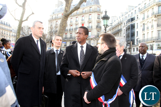 President Edgar Chagwa Lungu and First Lady Esther Lungu listens to Frence Ambassador to Zambia Emmanuel Cohet before he layed a wreaths at Place de la Republic to show solidarity to the victims that were killed during the terrorist attack on January 7,2015 in Paris. This was on arrival in Paris, France on Feb 6,2016 -Picture by THOMAS NSAMA