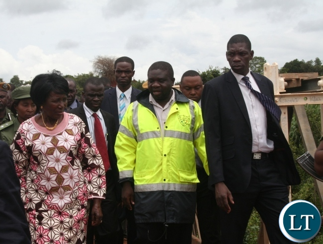 Acting President Inonge Wina (l) with North-Western province Disaster Management and Mitigation Unit (DMMU) regional coordinator Peter Kabaso during the inspection ofthe newlyconstructed Kimale Bailey bridge in Solwezi on Friday. The Acting President is in the region to inspect ongoing various developmental projects. Picture by BETRAM KAOMA /ZANIS