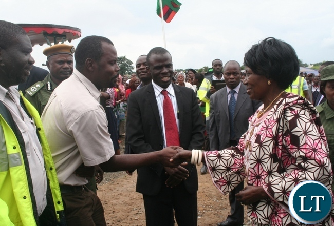 Acting President Inonge Wina (r ) is welcomed by North –Western province Road Development Agency (RDA ) regional manager Ndubeni Manda during the launch of the construction of Mushitala – Kimasala bridge in Solwezi on Fridayas Solwezi district commissioner Chipawa Chipawa (m) and DMMU regional coordinator Peter Kabaso look on. Picture by BETRAM KAOMA /ZANIS