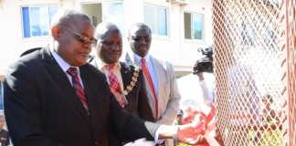 Lusaka Province Medical Officer Kennedy Malama(r) officially handover the Gen set and other Medical Equipments to the Chifundo Clinic in Chaisa Compound while Lusaka Mayor George Nyendwa(c) and National Aids Council Director General Jabbin Mulwanda(l) looks on