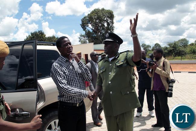 Inspector General Of Police Kakoma Kangaja welcomes President Lungu at the new Muchinga Police headquarters in Muchinga