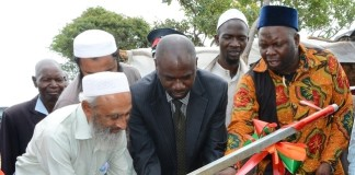 Chisamba District Commissioner Martin Chowa(c), Chief Chamuka VI of Mpikwa Village(r) and Muslim Social and Welfare Trust Representative Haroon Ghumra(l) officially handover the borehole to the people of Mpikwa Village in Chisamba District