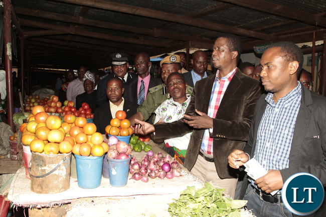 President Lungu buying food in Mpika Main Market during the tour
