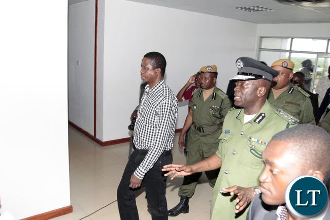 President Edgar Lungu and inspector General of Police Kakoma Kangaja inspects the New Muchinga Police Headmasters