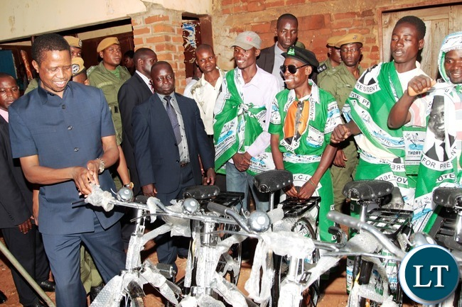 President Edgar Lungu looking at the bicycle shortly after his arrival at Navutika Market in Chipata